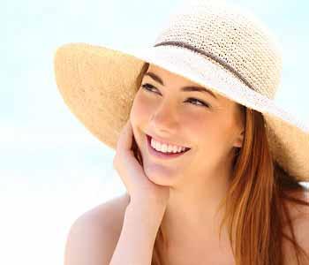Dr Gerald N. Bock, MD California Skin & Laser Center Smiling Woman wears Hat